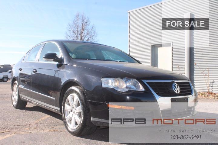 Volkswagen Passat T Black Leather Interior Hail Damage - Volkswagen collision repair